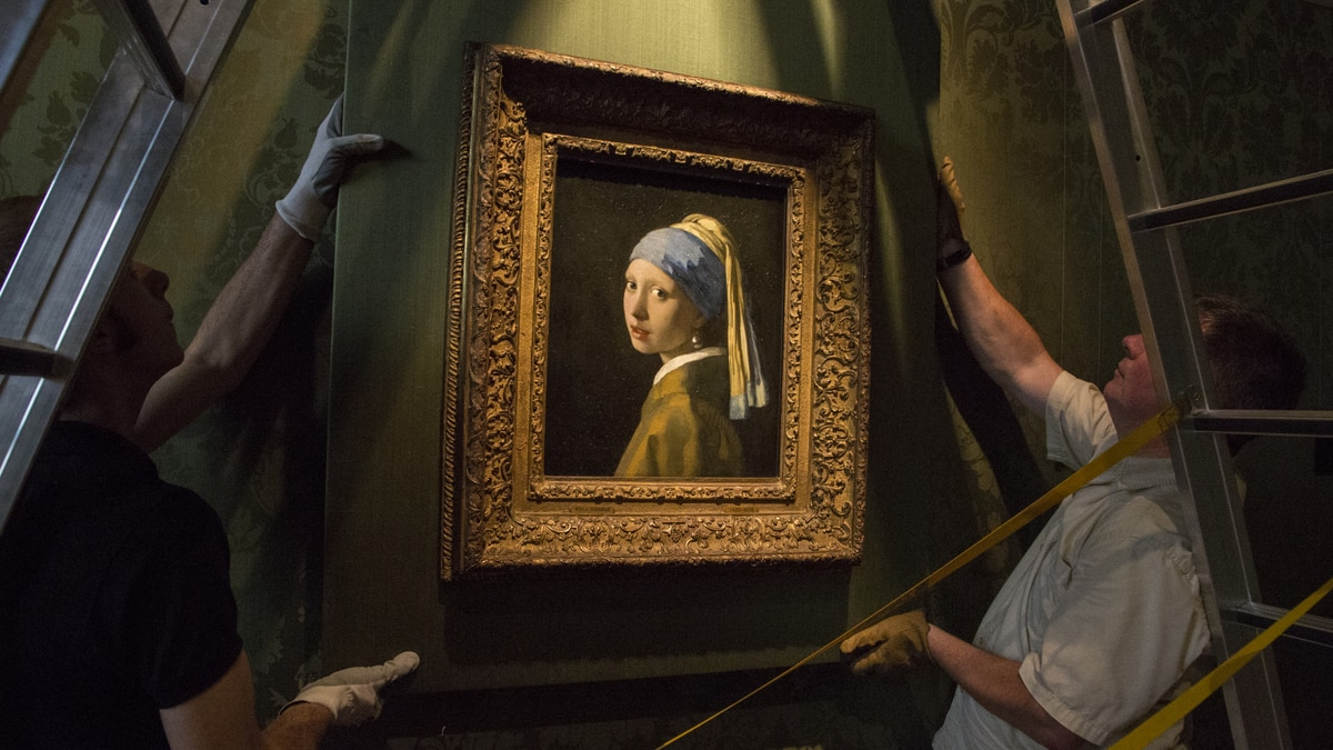 Girl With A Pearl Earring And...